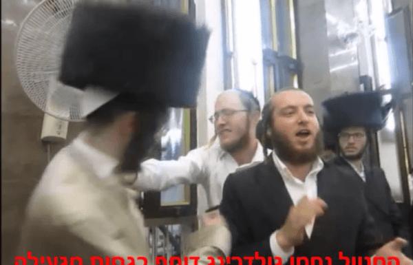 """נחמן גולדרינג דוחף בגסות ומעיף את השטריימל לאברך חשוב בהקפות שניות בשול ואח""""כ מוחה כפיים – האם מדובר במישהוא מזרע ישראל?"""